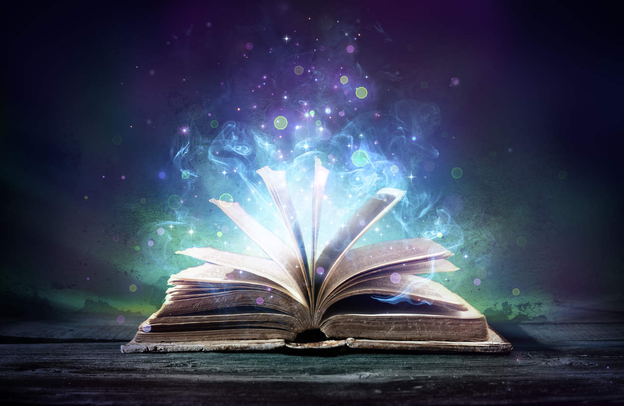 Open book with blue and purple background and light emitting from pages