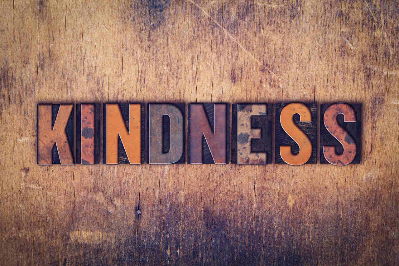 Word kindness on a wooden background