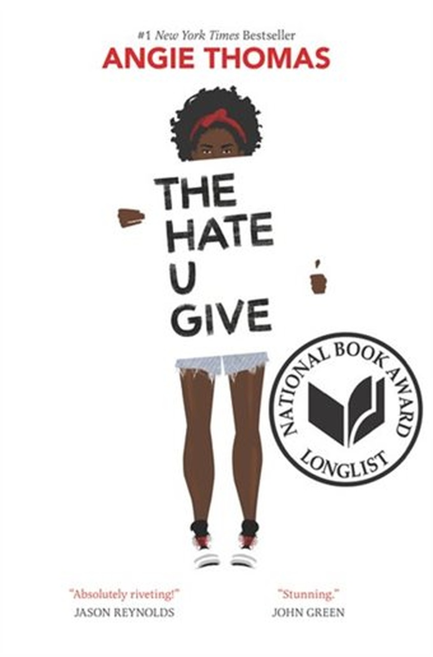 Girl holding a sign which reads The Hate You Give