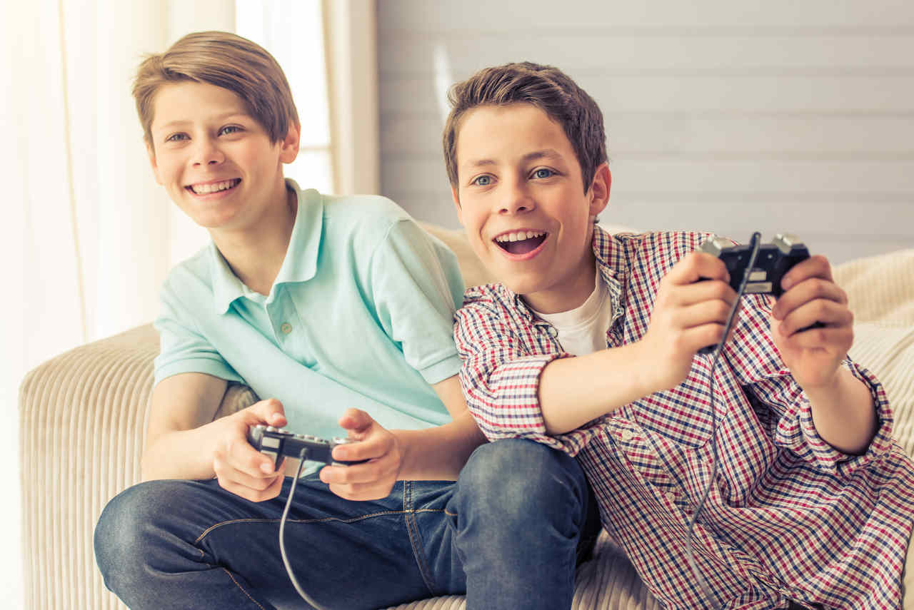 Two Teen Boys Playing Video Games
