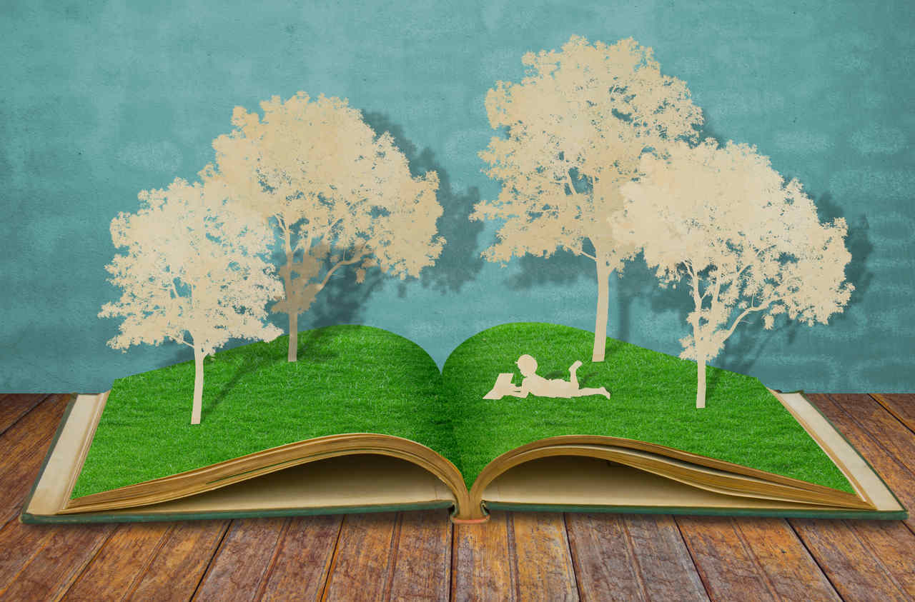 Open Book with Trees and Reader on Pages