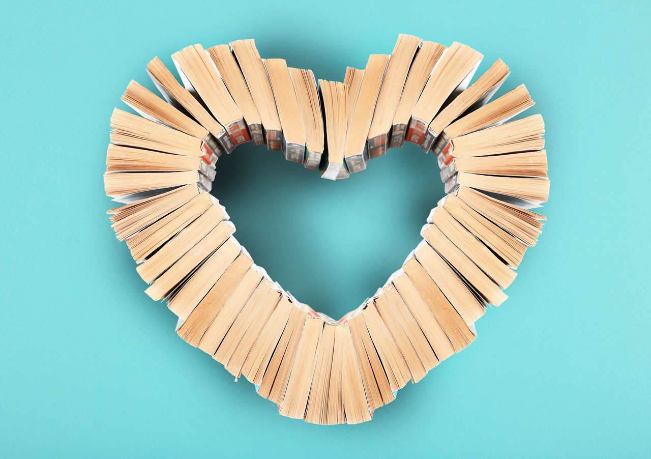 Heart made out of books, on a blue background