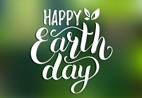 Words Happy Earth Day on green background